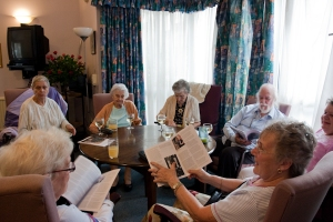 Pensioners at Fitzrovia Court admiring the finished publication of Ebb and Flow