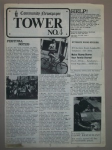 Front cover of newspaper with picture of woman on bicycle.