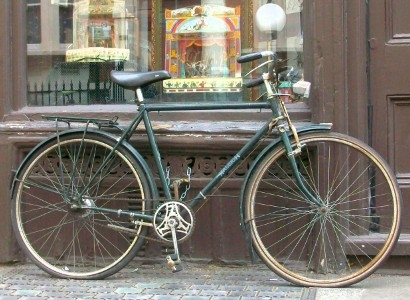 Bicycle outside shop.