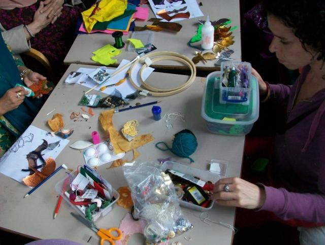 An art tutor selects materials.