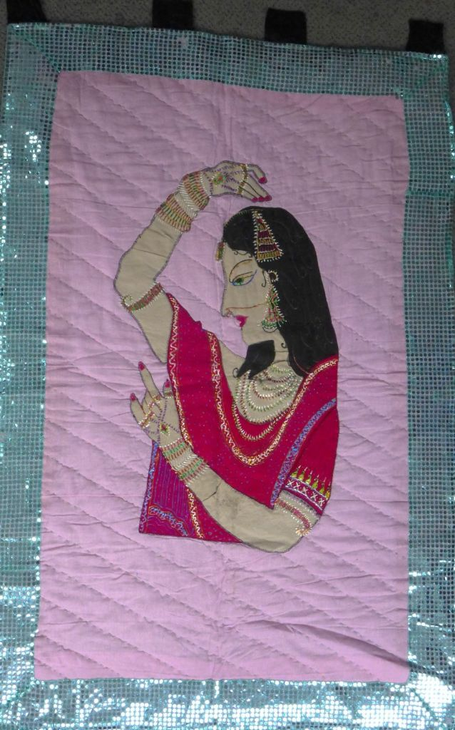Quilt with dancing lady.