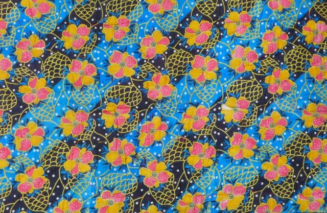 sari material, blue/black stripes with yellow and pink floral pattern.