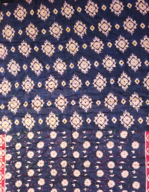 Sari material embroidery.