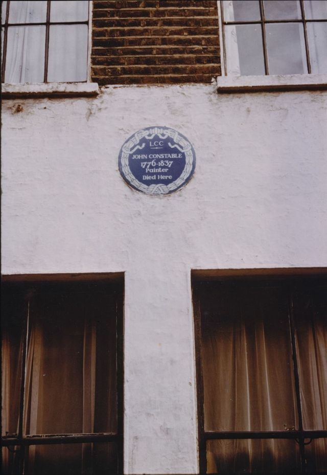 Blue plaque on wall.