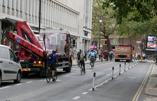 Cyclists and lorries in Torrington Place.