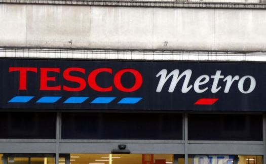 Tesco shop branding on front of store.
