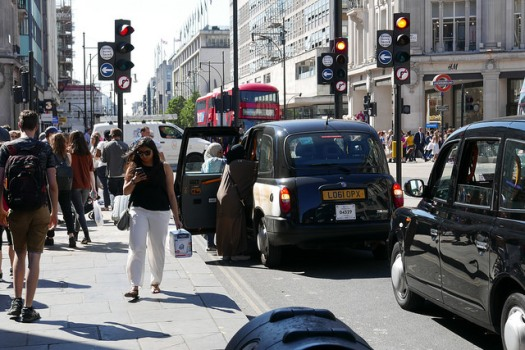 Shoppers, taxis and buses at Oxford Circus.